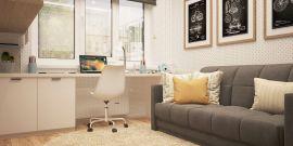 Chambre d'étudaint avec un bureau, un canapé, un tapis au sol et des cadres au mur